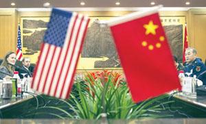Đại diện Trung Quốc và Mỹ trong cuộc đối thoại ngày 7.12 - Ảnh: AFP