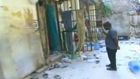 Cửa các phòng giam tại nhà tù ở thủ đô Haiti mở toang.