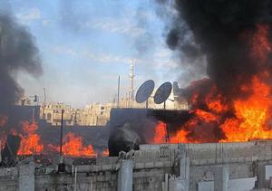 Thành phố Homs của Syria đang hứng pháo kích liên tục từ quân đội - Ảnh: AFP