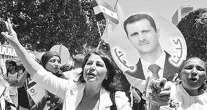 Người dân Xy-ri bày tỏ ủng hộ Tổng thống Át-xát.