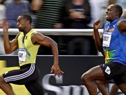 Gay (trái) đánh bại Bolt (phải)