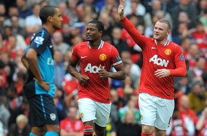 Rooney (ngoài cùng bên phải) đã gieo sầu cho Arsenal với cú hat-trick trong trận đấu này.