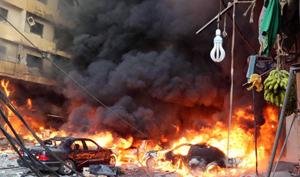 Hiện trường vụ đánh bom xe ở Li-băng ngày 15/8 (Ảnh: AFP/ Getty Images)