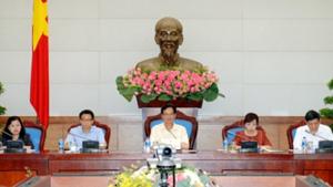 Thủ tướng Chính phủ Nguyễn Tấn Dũng (ở giữa) chỉ đạo tại cuộc họp liên quan đến dịch Ebola.