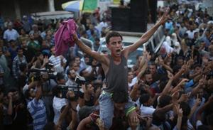 Người Palestine ăn mừng thỏa thuận ngừng bắn.