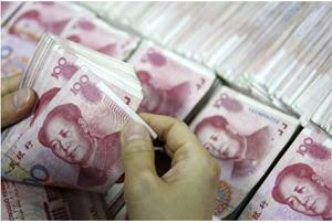 Giới phân tích hoàn toàn bất ngờ về động thái phá giá nhân dân tệ của Trung Quốc - Ảnh: AFP.